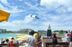 Wixair PJ-WIJ Plane flying over Maho Beach.jpg