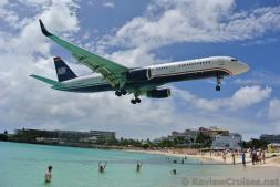 US Airways Boeing 737 N938UW Airplane flying over Maho Beach.jpg