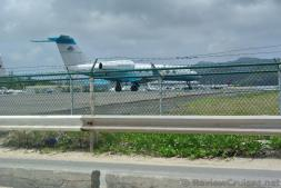Airplane behind barbed wire fence of Princess Juliana International Airport viewed from Maho Beach.jpg