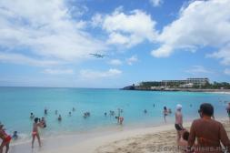 Twin Propeller Airplane flying over waters of Maho Beach.jpg