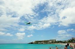 Small Single Propeller Airplane over the waters next to Maho Beach.jpg