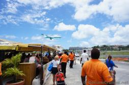 Small Airplane about to land at Princess Juliana International Airport.jpg