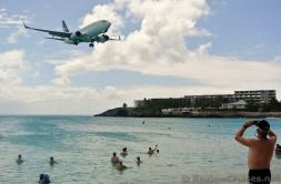 Twin Engine WestJet Airplane flying over Maho Beach.jpg