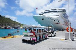 Tram escorting passengers from front of pier to cruise ships in St Martin.jpg