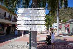 Direction signs in St Maarten cruise terminal plaza.jpg