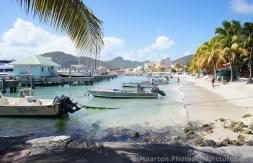 Small boats docked near beach of Philipsburg St Maarten.jpg