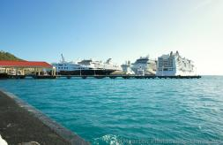 Several cruise ships docked at Philipsburg St Maarten as viewed from water taxi ramp.jpg