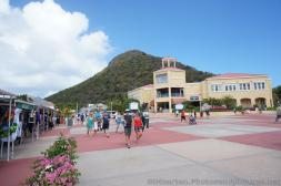 Tourists walk around the St Maarten cruise center.jpg